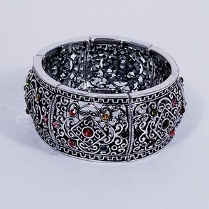Silver colored bangle with colored stones